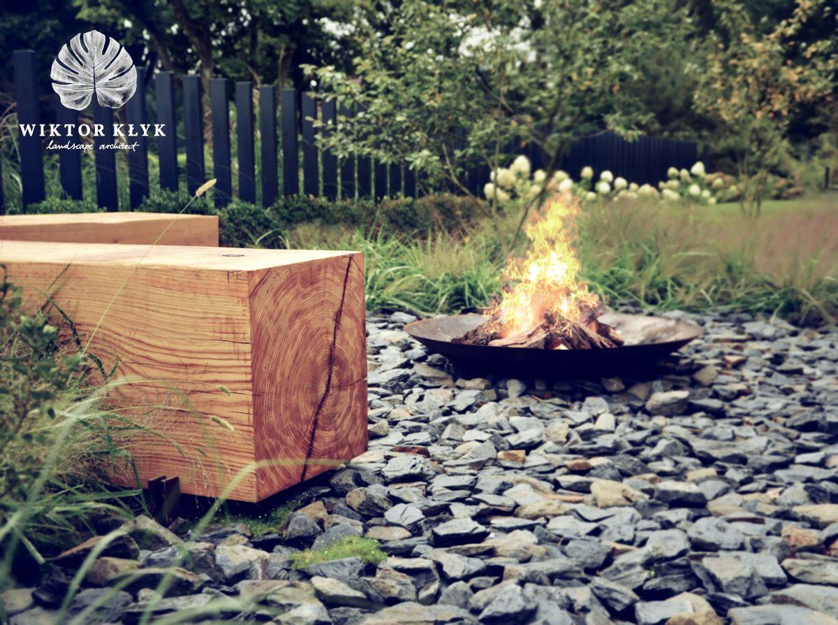 Fire pit with wooden bench